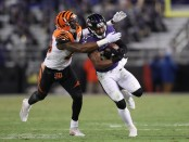 Cincinnati Bengals safety George Iloka attempts to make a play on Baltimore Ravens back Javorius Allen