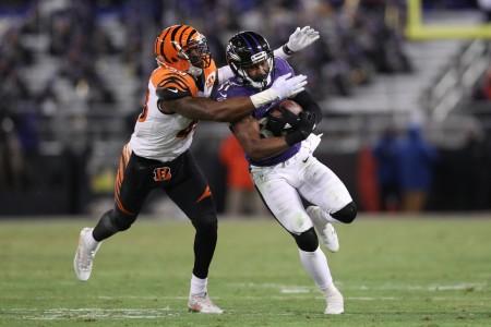 Cincinnati Bengals safety George Iloka attempts to make a play on Baltimore Ravens back Javorius Allen