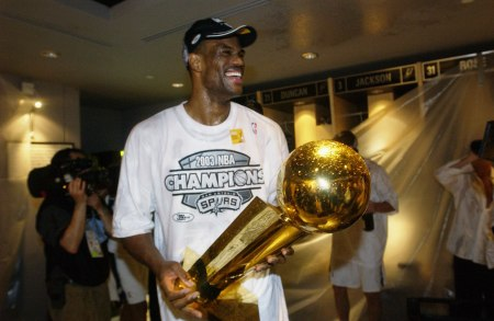 David Robinson with the Larry O'Brien Trophy after winning the NBA Championship