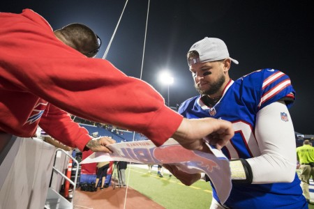 Buffalo Bills quarterback A.J. McCarron signs an autograph for a fan