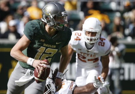 John Bonney attempts to make a play against the Baylor Bears