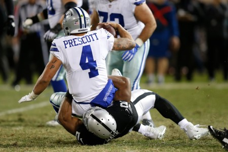 Oakland Raiders pass rusher Khalil Mack tackles Dallas Cowboys quarterback Dak Prescott