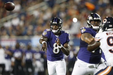 Lamar Jackson attempts a pass against the Chicago Bears