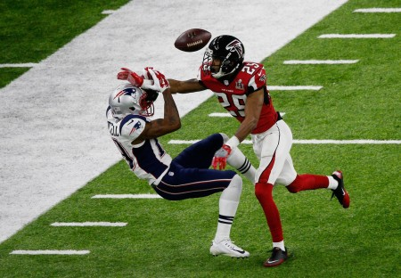 Malcolm Mitchell tries to catch the ball against the Falcons in the Super Bowl