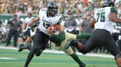 Hawai'i Rainbow Warriors quarterback Cole McDonald carrying the football against Colorado State