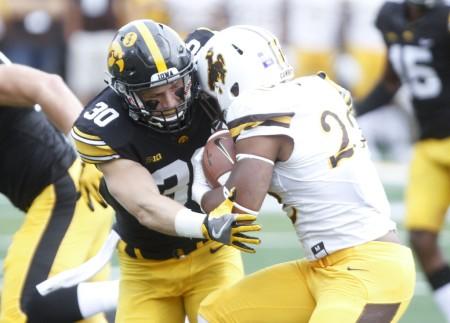 Wyoming running back Nico Evans rushing the ball against Iowa