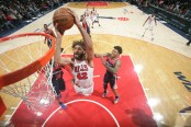 Robin Lopez goes flying, as he looks to throw down a dunk