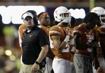 Texas Longhorns head coach Tom Herman watches a replay against the Kansas Jayhawks