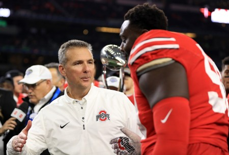 Ohio State head coach Urban Meyer celebrates with one of players after their Bowl win