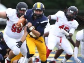 TCNJ quarterback Dave Jachera running from the Frostburg State defense