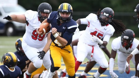 TCNJ quarterback Dave Jachera running from the Frostburg State defense