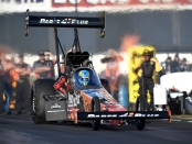 Great Clips/Parts Plus Top Fuel Dragster Pilot Clay Millican racing earlier this season