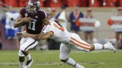 Texas A&M Aggies quarterback Kellen Mond tries to escape a tackle from a Clemson player
