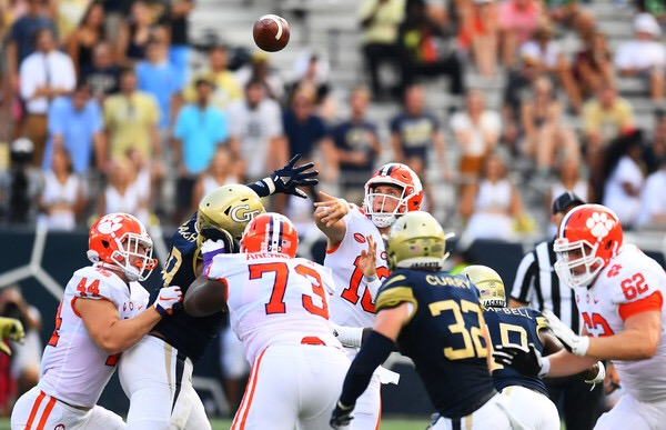 Clemson Tigers quarterback Trevor Lawrence throws a pass against the Georgia Tech Yellow Jackets