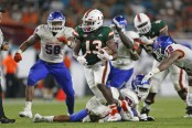 Miami (Florida) Hurricanes running back DeeJay Dallas rushing the ball against the Savannah State Tigers
