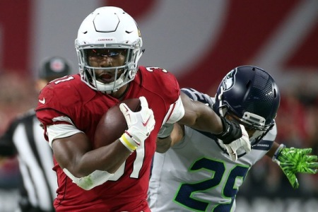 Seattle Seahawks All-Pro Safety Earl Thomas attempting to tackle Arizona Cardinals running back David Johnson
