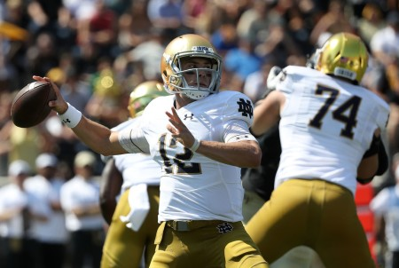 Notre Dame Fighting Irish quarterback Ian Book drops back to pass against the Wake Forest Demon Deacons