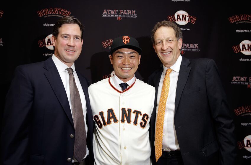 San Francisco Giants general manager Bobby Evans with Giants President and CEO Larry Baer and Norichika Aoki