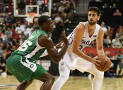 Boston Celtics guard Jabari Bird guarding Philadelphia 76ers swingman Furkan Korkmaz.