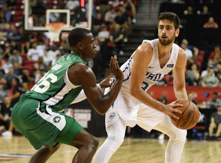 Boston Celtics guard Jabari Bird guarding Philadelphia 76ers swingman Furkan Korkmaz.