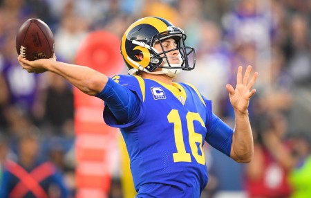 Los Angeles Rams quarterback Jared Goff throwing a touchdown pass against the Minnesota Vikings