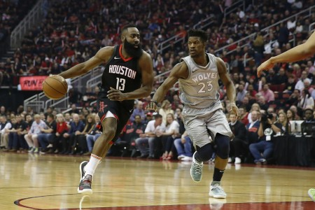 Minnesota Timberwolves star Jimmy Butler playing defense against Houston Rockets star James Harden
