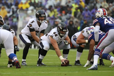 Baltimore Ravens quarterback Joe Flacco gets ready to receive the snap from the center against the Buffalo Bills