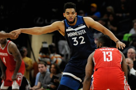 Minnesota Timberwolves center Karl-Anthony Towns attempts to guard Houston Rockets star James Harden while being called for a foul