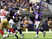 Minnesota Vikings quarterback Kirk Cousins throws a pass against the San Francisco 49ers