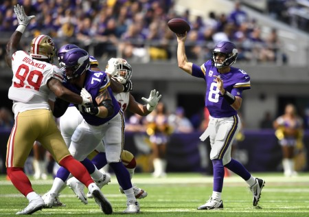 Minnesota Vikings quarterback Kirk Cousins throws a pass against the San Francisco 49ers