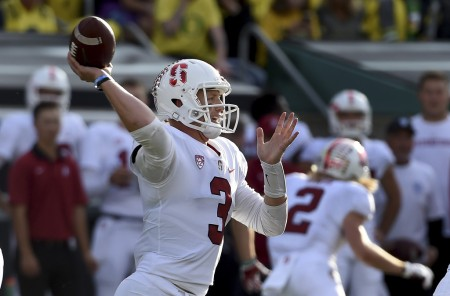 Stanford Cardinal quarterback K.J. Costello throwing a pass against the Oregon Ducks