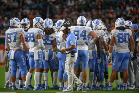North Carolina Tar Heels head coach Larry Fedora walking past his players in the first quarter against the Miami (Florida) Hurricanes