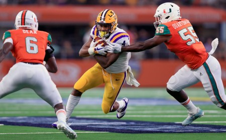 LSU Tigers running back Nick Brossette rushing against the Miami (Fla.) Hurricanes at AT&T Stadium