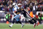 Tennessee Titans wide receiver Rishard Matthews being tackled by New England Patriots safety Eric Rowe
