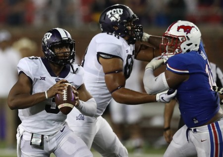 TCU quarterback Shawn Robinson looks down the field to make a play
