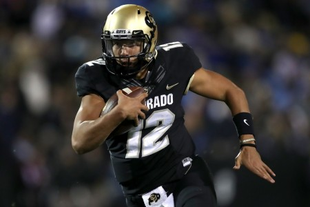 Colorado Buffaloes quarterback Steven Montez rushing the ball against the UCLA Bruins