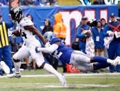 Jacksonville Jaguars running back T.J. Yeldon rushing the ball in the second quarter against the New York Giants