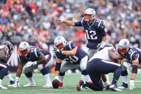 New England Patriots quarterback Tom Brady calls signs at the line against the Houston Texans