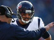 Houston Texans quarterback Tom Savage talking to head coach Bill O'Brien during the second half of a 2017 game