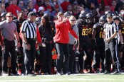 Then-Maryland Terrapins head coach D.J. Durkin coaching against the Minnesota Golden Gophers