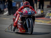 Denso Auto Parts/Elite Performance Pro Stock Motorcycle rider Matt Smith racing on Friday at the AAA Texas NHRA FallNationals