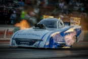 Make-A-Wish Foundation Funny Car pilot Tommy Johnson Jr. racing on Friday at the Texas Motorplex