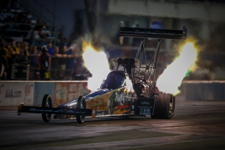 Great Clips/Parts Plus Top Fuel Dragster pilot Clay Millican racing on Friday at the AAA Texas NHRA FallNationals