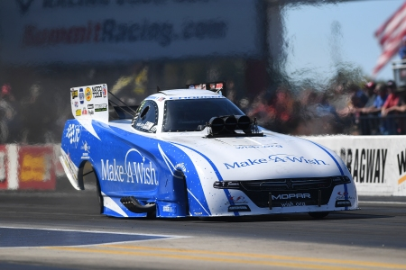 Make-A-Wish Foundation Funny Car pilot Tommy Johnson Jr. racing on Saturday at the NHRA Carolina Nationals