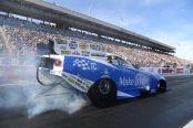 Make-A-Wish Foundation Funny Car pilot Tommy Johnson Jr. racing on Saturday at the NHRA Toyota Nationals