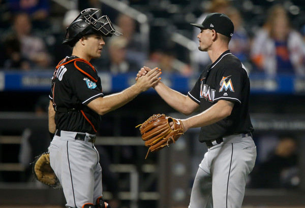 Catcher J. T. Realmuto and pitcher Nick Wittgren celebrating a Miami Marlins win over the New York Mets