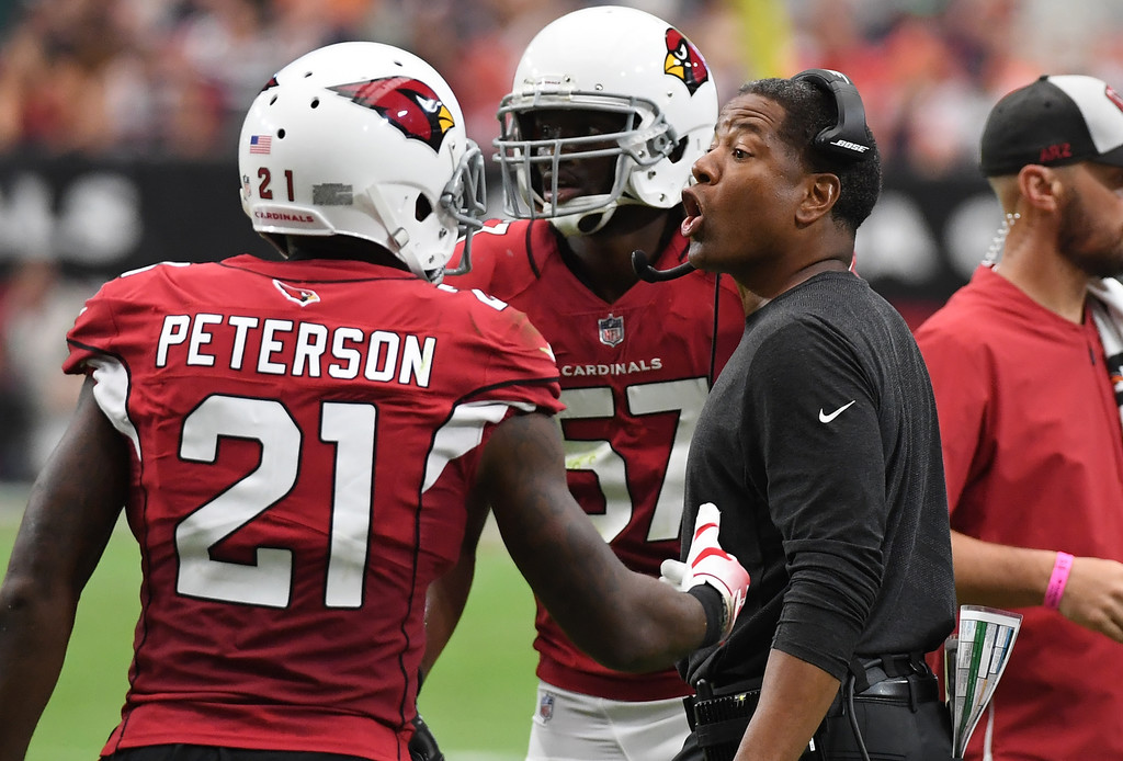 Former Arizona Cardinals head coach Steve Wilks talks to Patrick Peterson during the first half against the Chicago Bears
