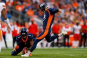 Denver Broncos punter Marquette King holding the ball on a Brandon McManus field goal attempt