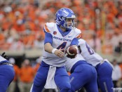 Boise State Broncos quarterback Brett Rypien looks to hand off the ball against the Oklahoma State Cowboys