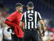 Maryland Terrapins hews football coach D.J. Durkin talks to an official during a bowl game